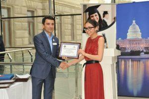 Nazrin Agharzayeva'13 receives her award from Fariz Ismayilzade'96-the founder of AAA