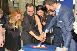 The AAA board cutting the cake