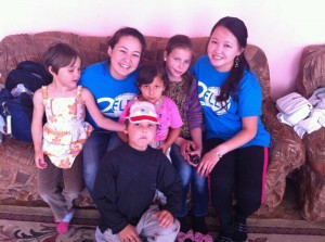 FLEX alumni at the orphanage on June 1_left Tolgonai Turgazieva_right Sanira Begim Mamatova