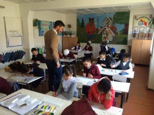 Nurgul Irisova - Nurgul Irisova '13 (PC volunteer Cole Bedford working with kids on their drawings)