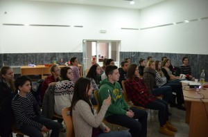 5 FLEX alumni, listening to Violeta Milanovic's '15 presentation about Human Rights